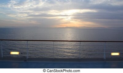 sunset in sea, view from deck of ship