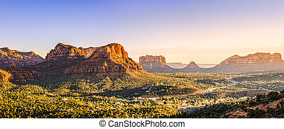 Scenic view to Courthouse Butte, Bell Rock and surrounding red rocks formations in Sedona, Arizona at sunset