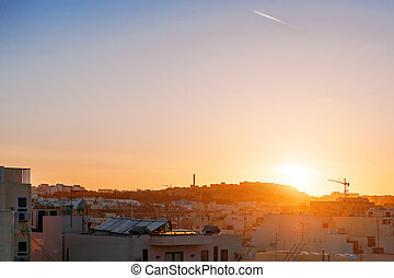 Sunset in Sliema. Malta. Cityscape with clear sky.