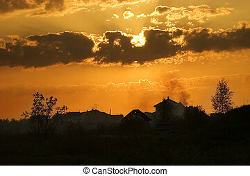 Sunset in suburbia - Evening summer sun in clouds and ...