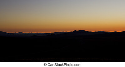Sunset in the Atacama Desert. Silhouette of the mountains as the sun goes down. Atacama, Chile.