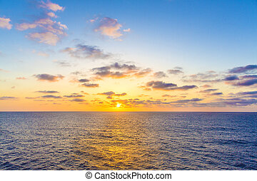Sunset in the Atlantic Ocean. Beautiful sunset in the ocean view from the ship. View from the cruise ship.