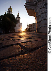 sunset in the city amid cobblestones