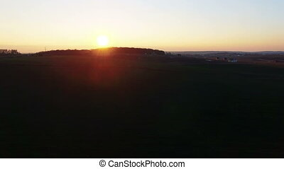 Sunset in the field. Aerial view