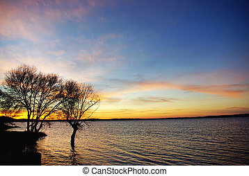 Sunset in the lake Alqueva.