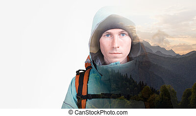 Sunset in the mountains and hiker man with backpack. Double exposure effect photography.