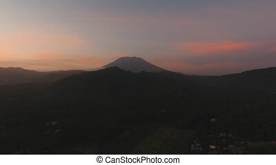 Sunset in the mountains in Bali, Indonesia. - Aerial view of...