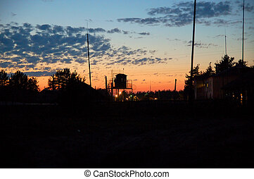 sunset in the orange sky setting over prison yard