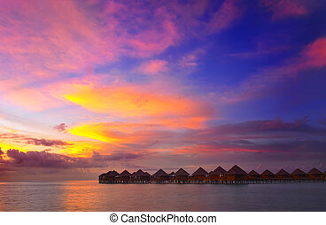 Sunset in the paradise - Beautiful vivid sunset over water ...