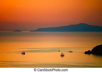 Sunset in the sea of santorini
