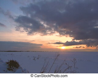 Sunset in the winter snow field.