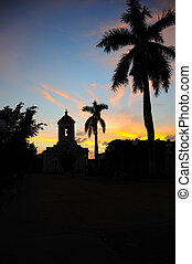 Sunset in Trinidad, cuba - Silhouette of church and royal...