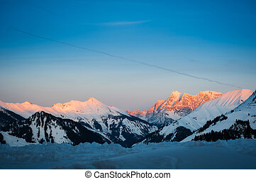 sunset in tyrol snow mountain alps at winter