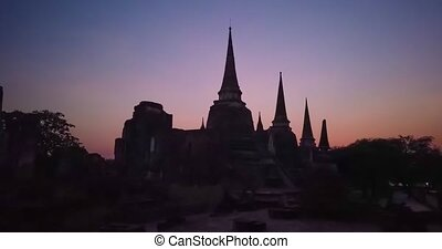 Timelapse of sunset in Wat Phra Si Sanphet temple in Ayutthaya, Thailand at night. 4K time lapse video clip