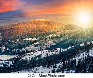sunset in winter carpathians - carpathian mountain rural...