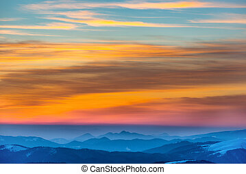 Sunset in winter mountains