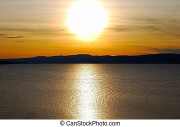 Sunset. Lake Baikal. Olkhon island. Mountains on horizon.