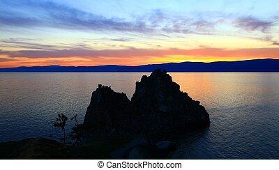 Sunset. Lake Baikal. Olkhon island. Mountains on horizon.