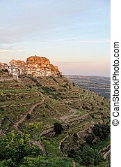 Sunset landscape mountain view of the old town Ares in Spain.