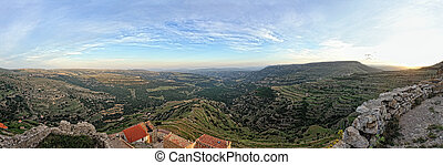 Sunset landscape of the small town with mountain view. Ares in Spain. Pamoramic view.