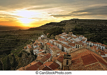 Sunset landscape of the small town with mountain view. Ares in Spain.