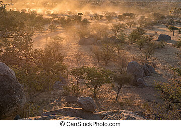 Sunset landscape with lots of dust at the Hoada Camp