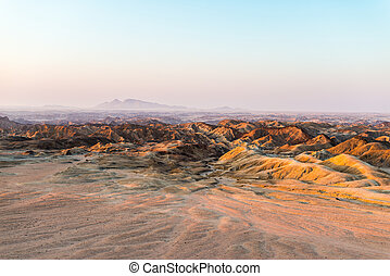 """Sunset light over barren valleys and canyons, known as """"moon landscape"""", Namib desert, Namib Naukluft National Park, among the most important travel destination in Namibia, Africa."""