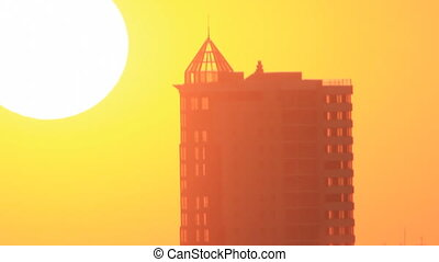 Sunset light through skyscraper