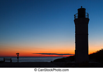 Robert H. Manning Memorial Lighthouse silhouetted by the setting sun over Lake Michigan near Empire.