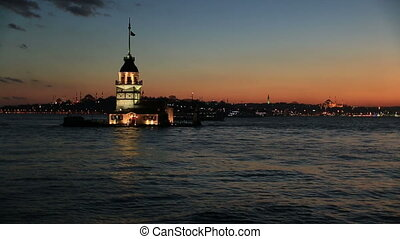 maiden tower - sunset maiden tower with passenger ship