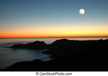 Sunset Moon - A beautiful sunset over the bay with a full...