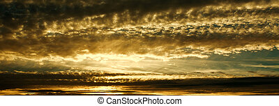 Sunset nature background, golden clouds in evening sky