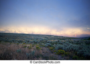 Sunset of rolling hills and scrub in Wyoming