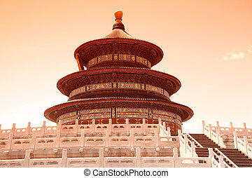 Sunset of The Imperial Vault of Heaven sits in the center in The Beiging, China. It is a round building with a roof that resembles the Hall of Prayer for Good Harvests