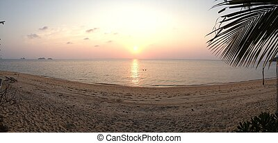 Sunset on a beach panorama