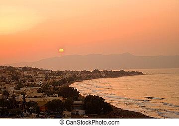 Sunset on a beautiful beach in Greece