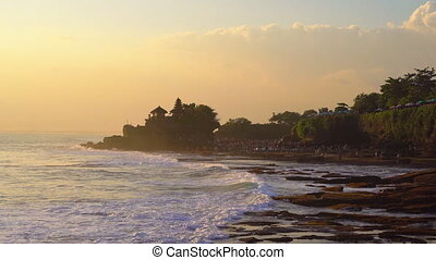 Sunset on a beautiful Tanah Lot temple on the Bali island.