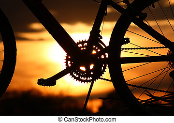 Mountain bike silhouetted by Tucson sunset