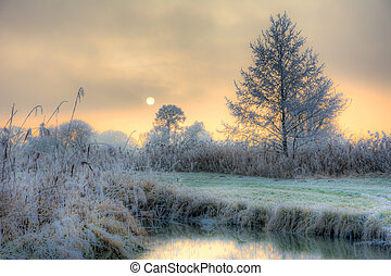 Sunset on a foggy winter day at the river Paar in a...