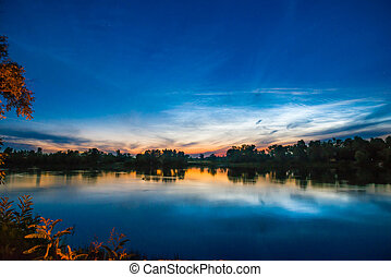 Sunset on a lake with forest