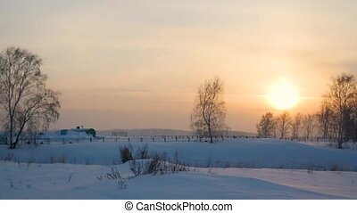 sunset on a snow slope. snow winter landscape