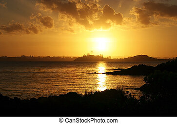 Sunset on Auckland City including the skytower. Shot from Rangitoto Island
