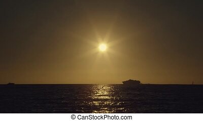Sunset on formentera island with boat going past