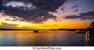sunset on lake at twilight