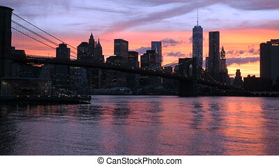 Sunset on Manhattan - Sunset on the Brooklyn Bridge and...