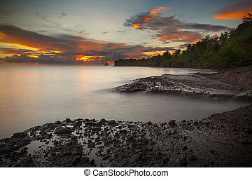 Sunset on the island of Martinique taken with long exposure to soften the ocean
