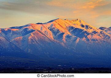Sunset on Mountain Top in Winter Orange Beautiful Light