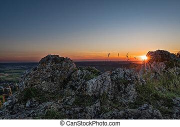Sunset on mountain Walberla in Franconian Switzerland