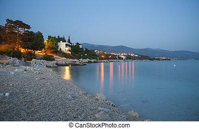 Sunset on Novi Vinodolski beach, Croatia - Beach in sunset ...