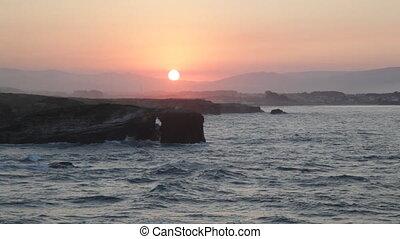 sunset on Playa de las Catedrales, Spain